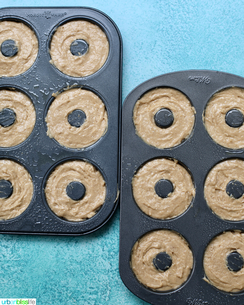 apple cinnamon donut batter in donut pans