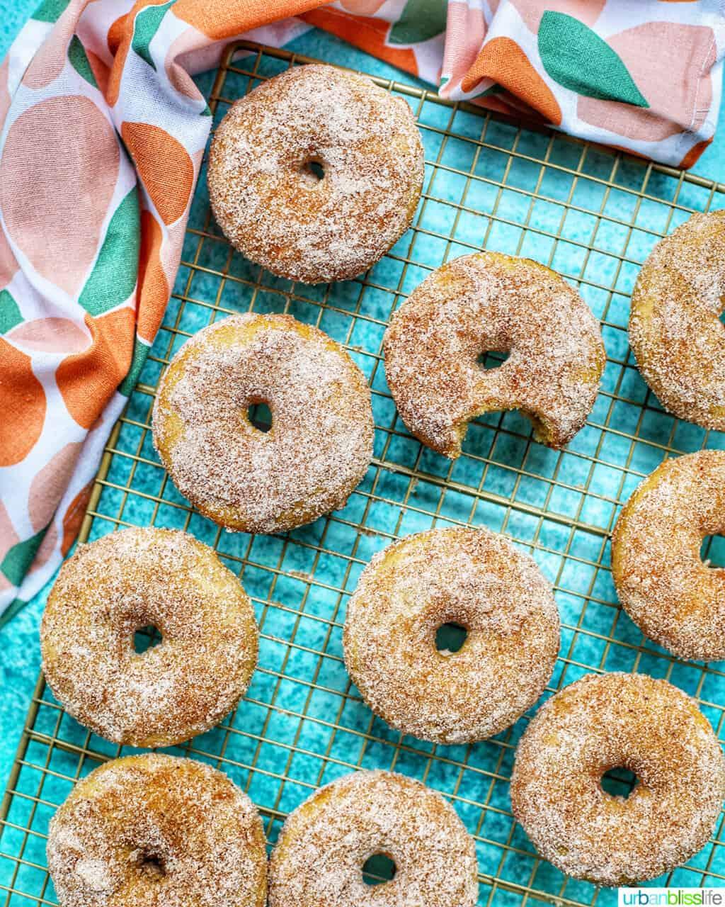 cooling rack of apple cinnamon donuts