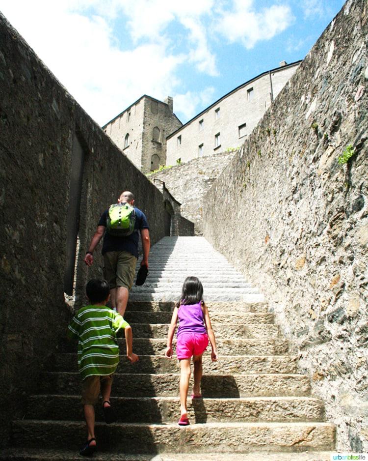walking up steep steps to the Castles of Bellinzona