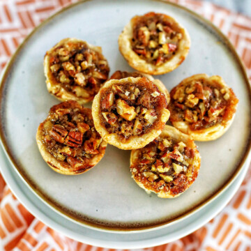 mini pecan pies centered on a plate