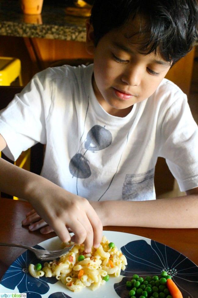 Kid eating Horizon Organics Gluten Free Mac and Cheese