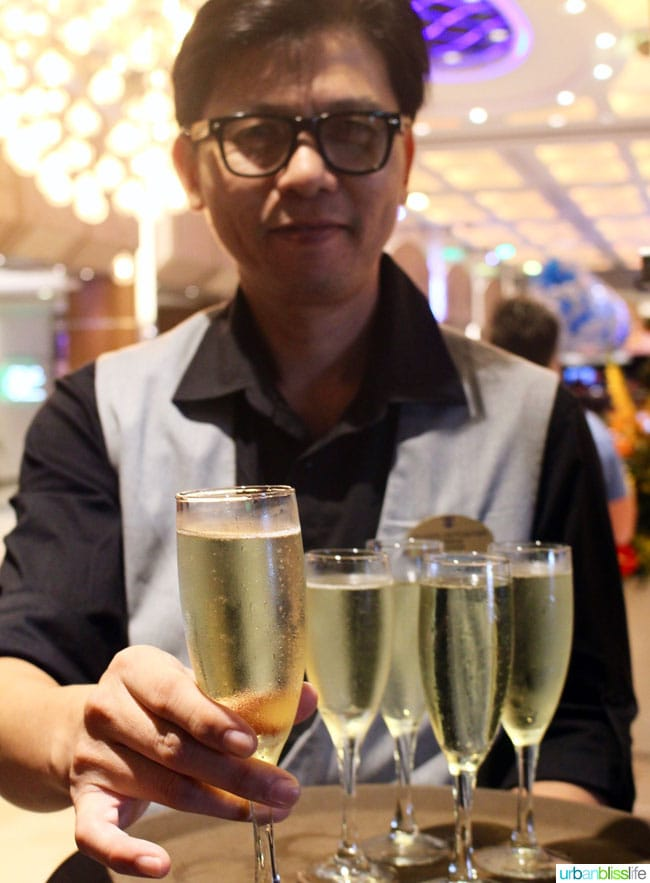 waiter with glasses of champagne