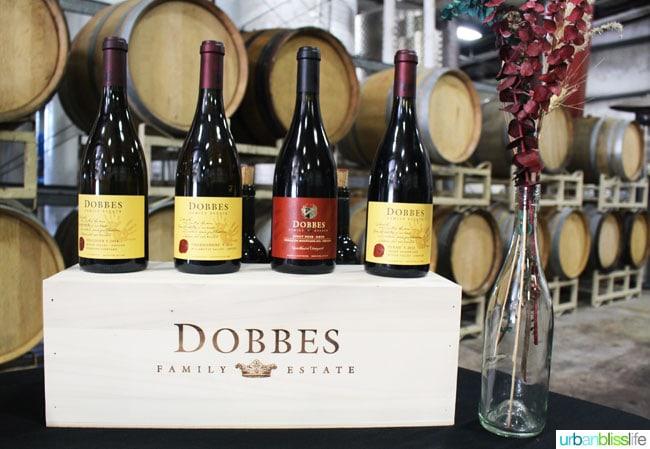 Dobbes WInery wine bottles in barrel room