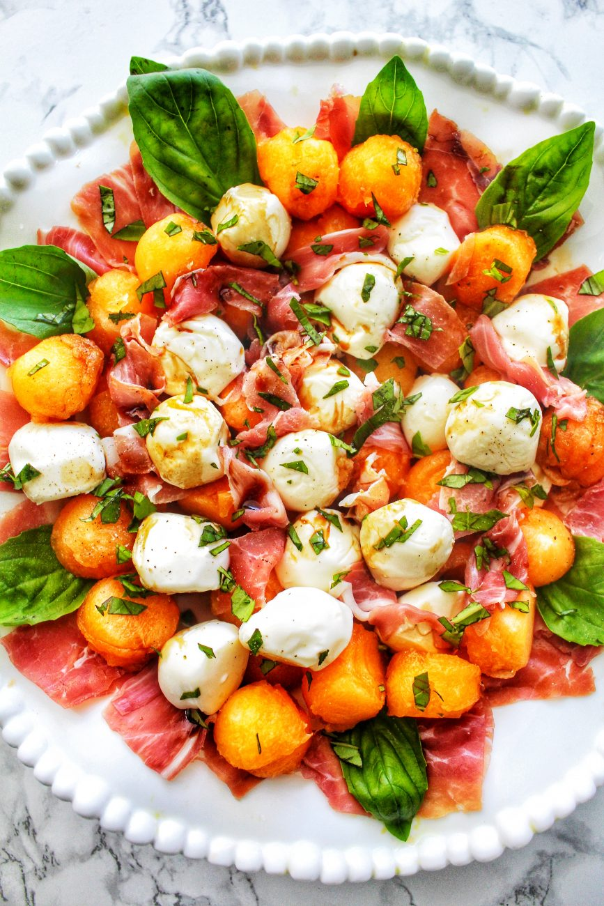 bowl of melon prosciutto caprese salad