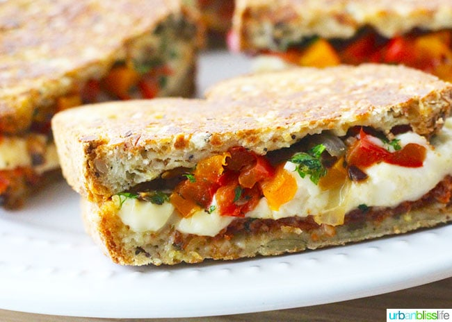 Chorizo sandwich half with cheese and peppers oozing out