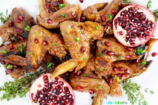 Cranberry Pomegranate Sticky Chicken Wings recipe on http://UrbanBlissLife.com