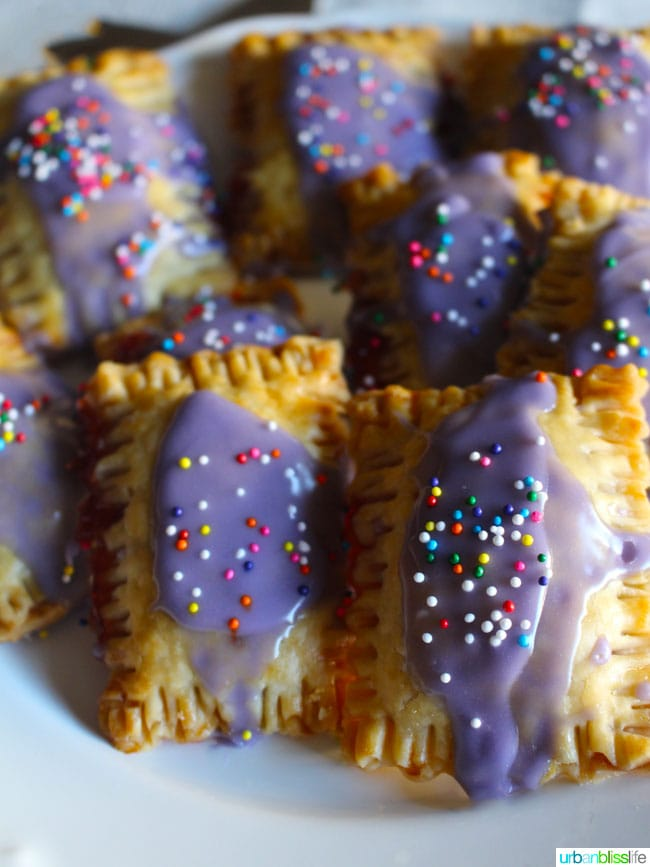 Mini Pop Tarts are adorable miniature twists on an old classic snack, and Mini Lolli-Pop Tarts make adorable Valentine's Day Treats! Recipe on UrbanBlissLife.com