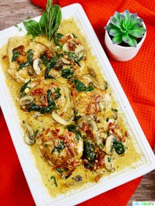Chicken with Creamy Sun-dried Tomato Mushrooms and Spinach Sauce recipe on UrbanBlissLife.com