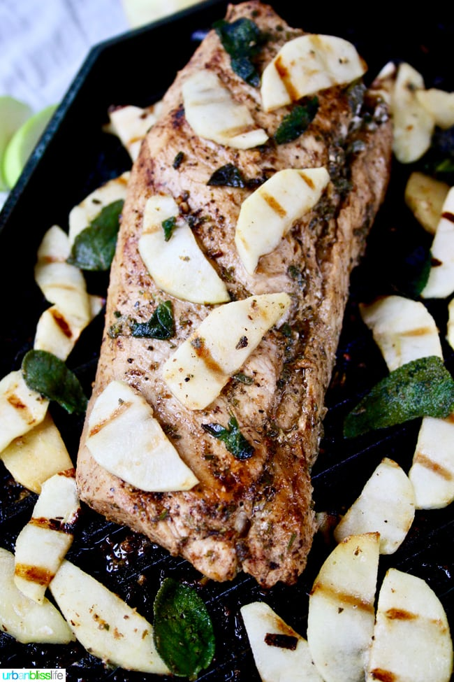 Grilled Pork Tenderloin with Hard Cider, Apples and Sage on cast-iron pan