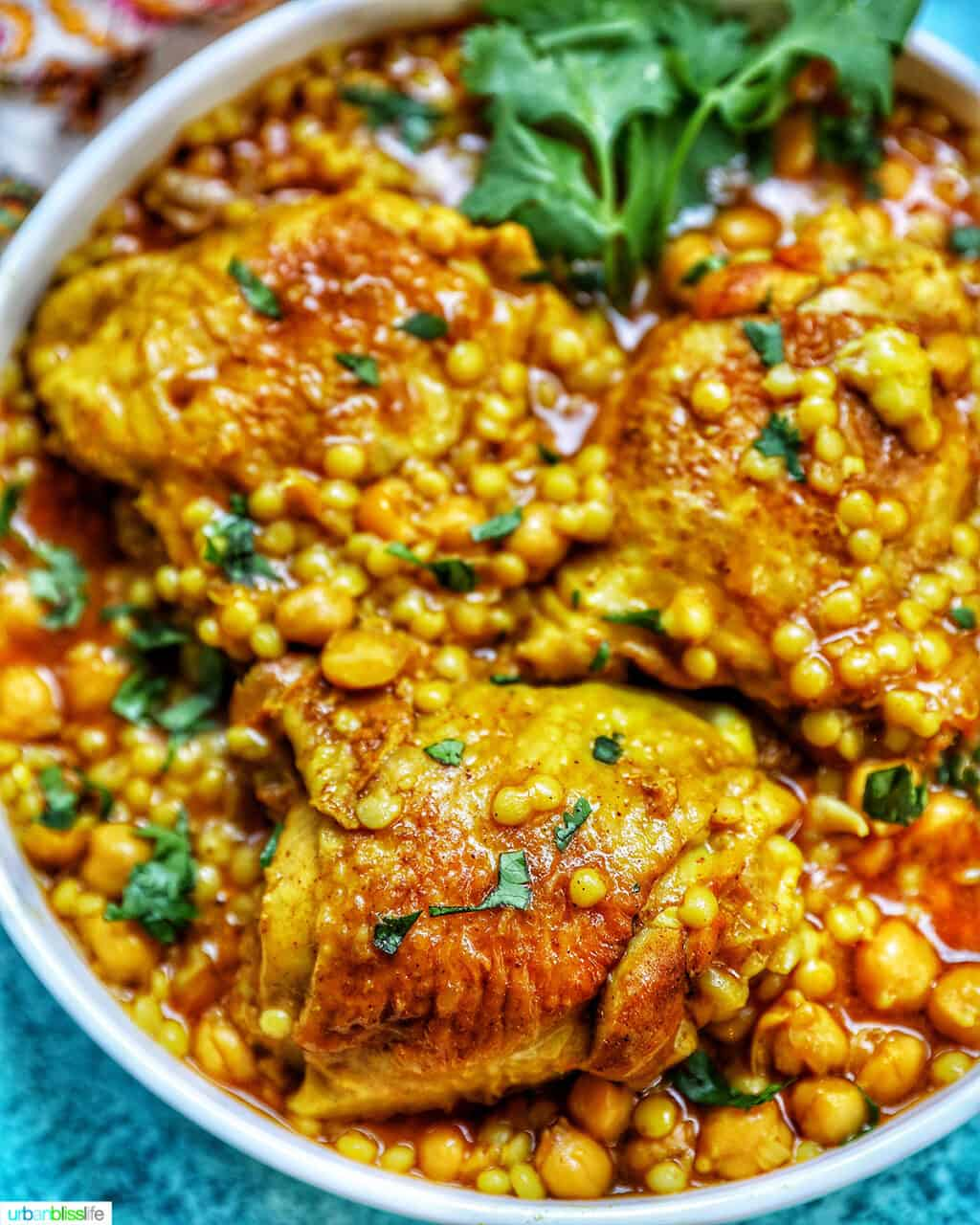 colorful picture of Instant Pot Moroccan Chicken in a large serving bowl