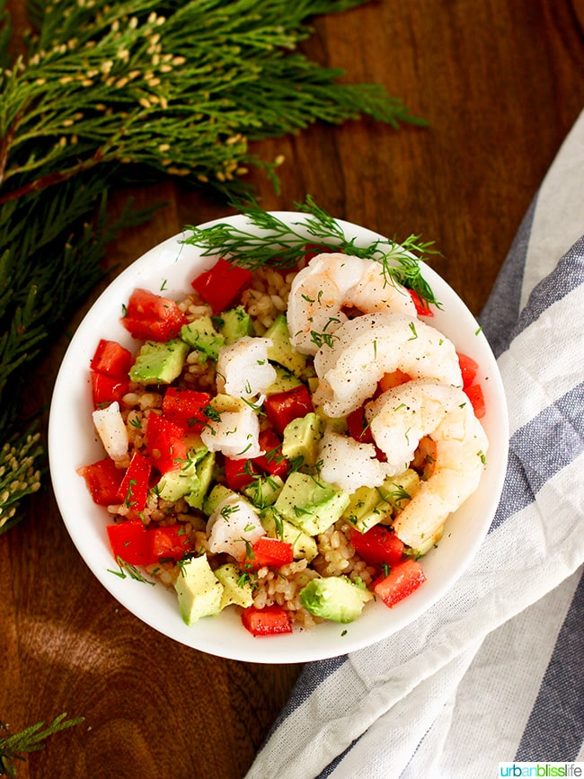 Gluten free dairy free recipes - shrimp avocado rice bowl with napkin and leaves