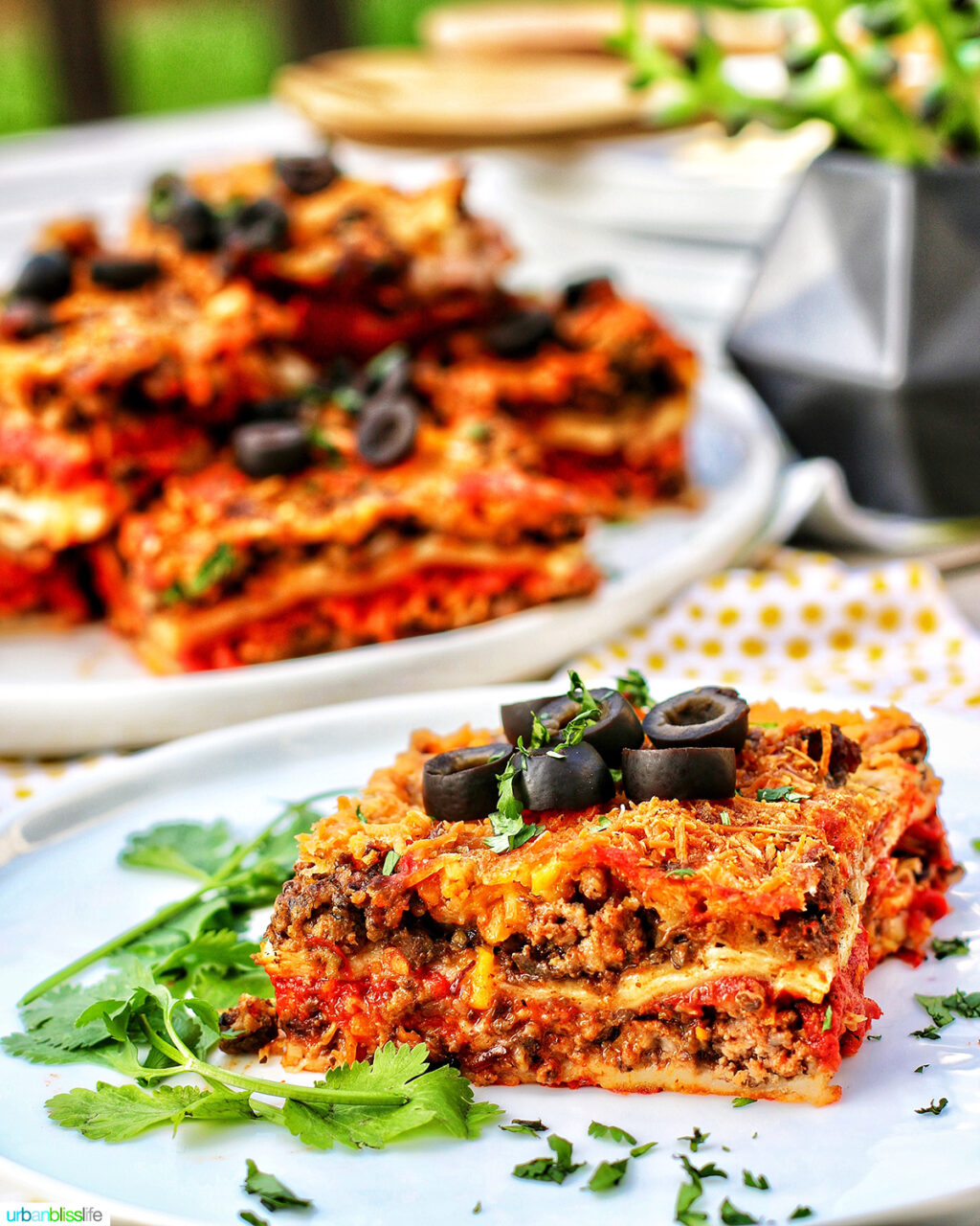 Mexican lasagna slice with more slices in the background