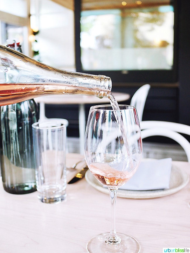 rose wine pouring at Tusk weekend happy hour