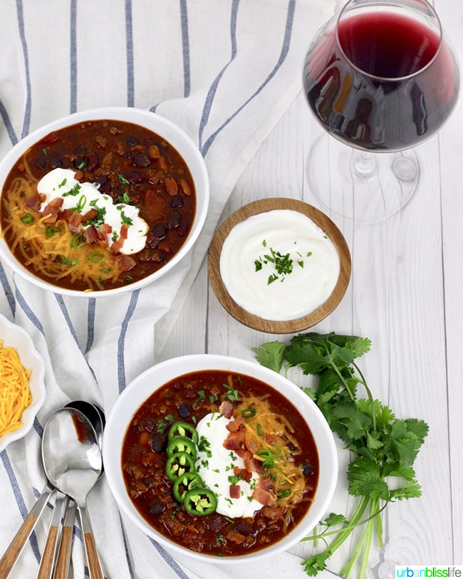chili in bowls with red wine