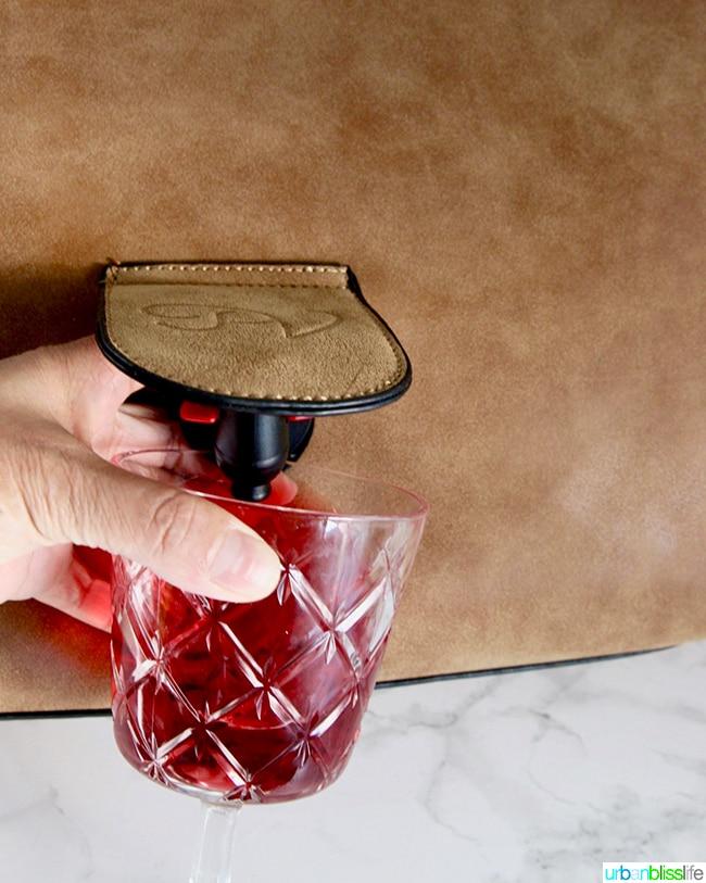 Portovino messenger bag pouring wine