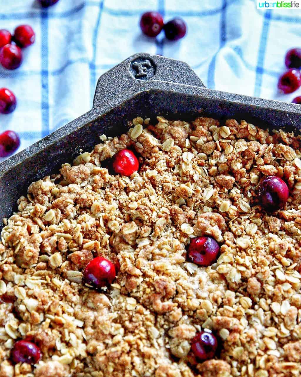 closeup corner of pan with apple cranberry crisp
