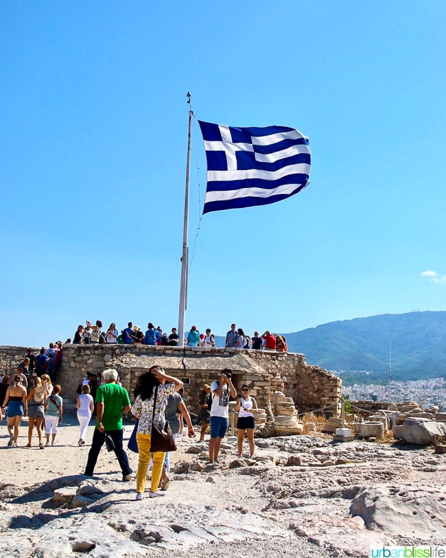 Greek flag flying at the top of the Acropolis