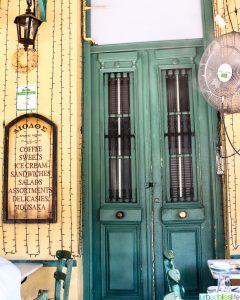 green door on storefront in Athens, Greece