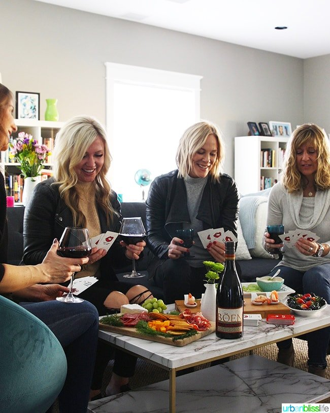 girls' night game night with red wine and food