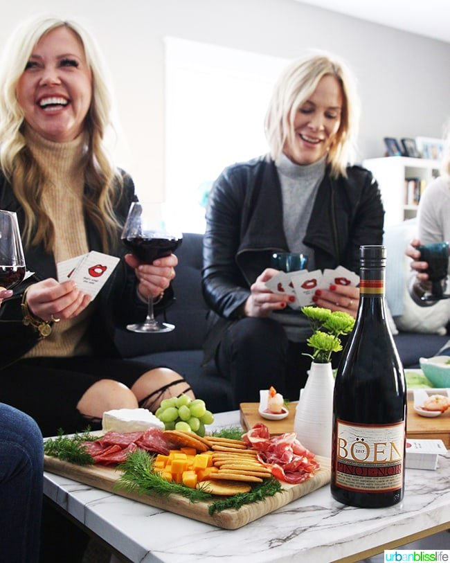 good friends enjoying game night with red wine