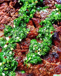 Cast iron rib eye steak with chimichurri sauce