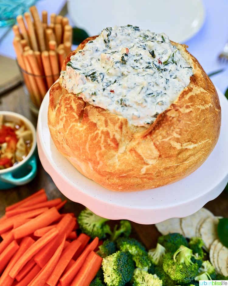 spinach dip in bread bowl with veggies