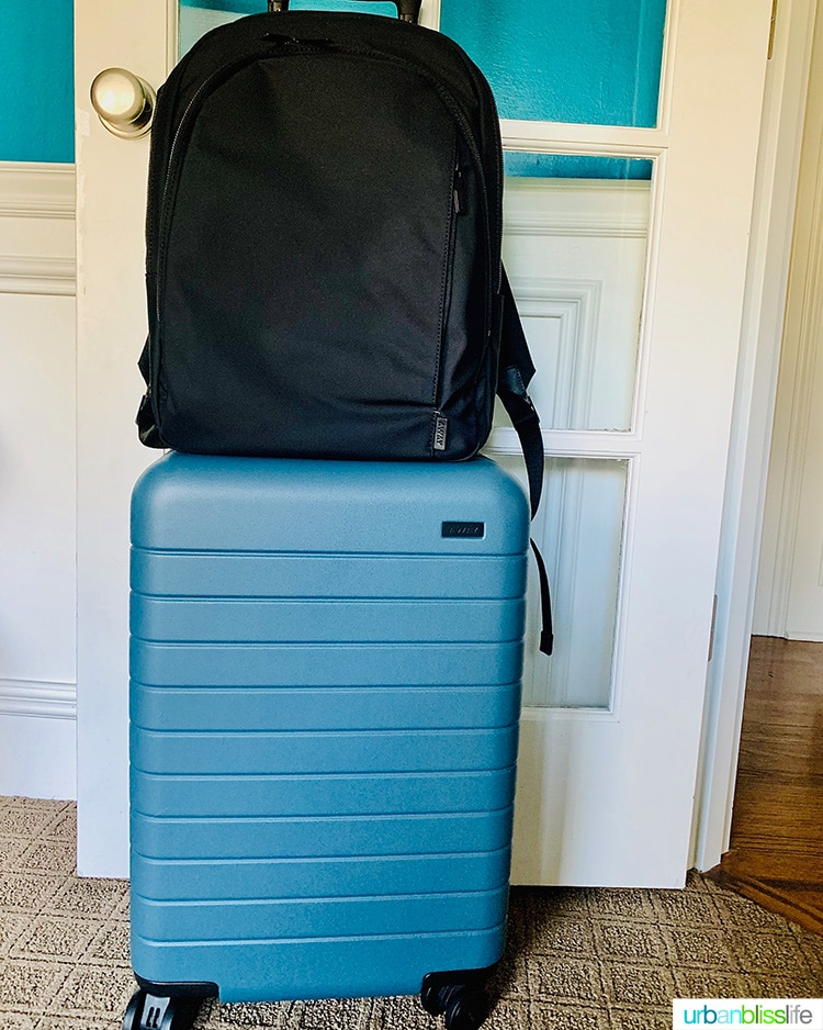 Away Luggage - Backpack on top of Bigger Carry-On