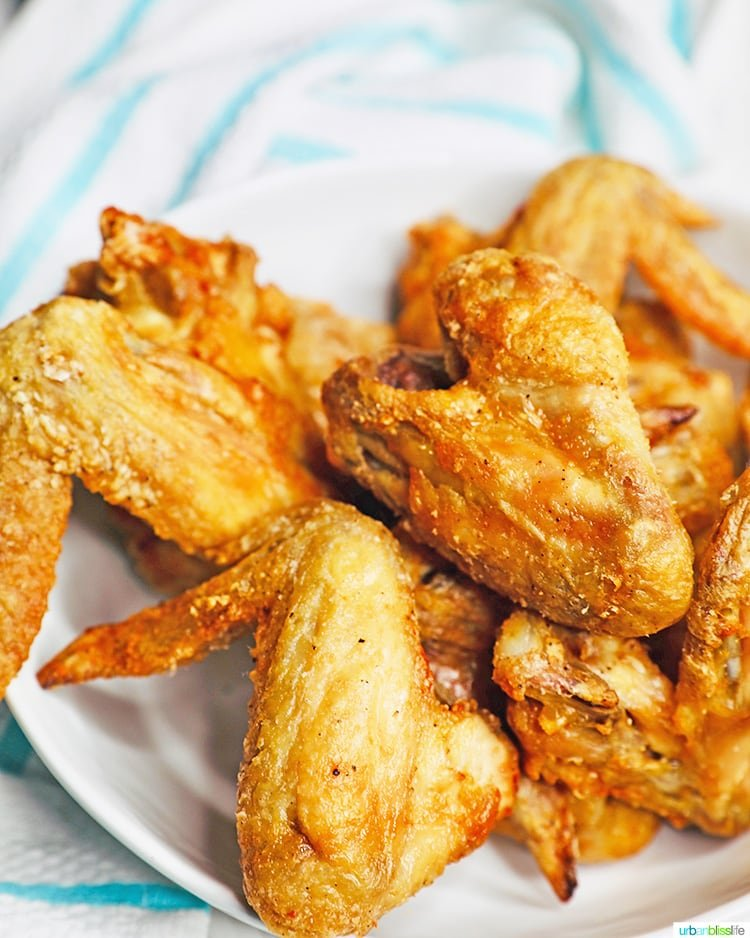 crispy air fryer chicken wings in a bowl with towel