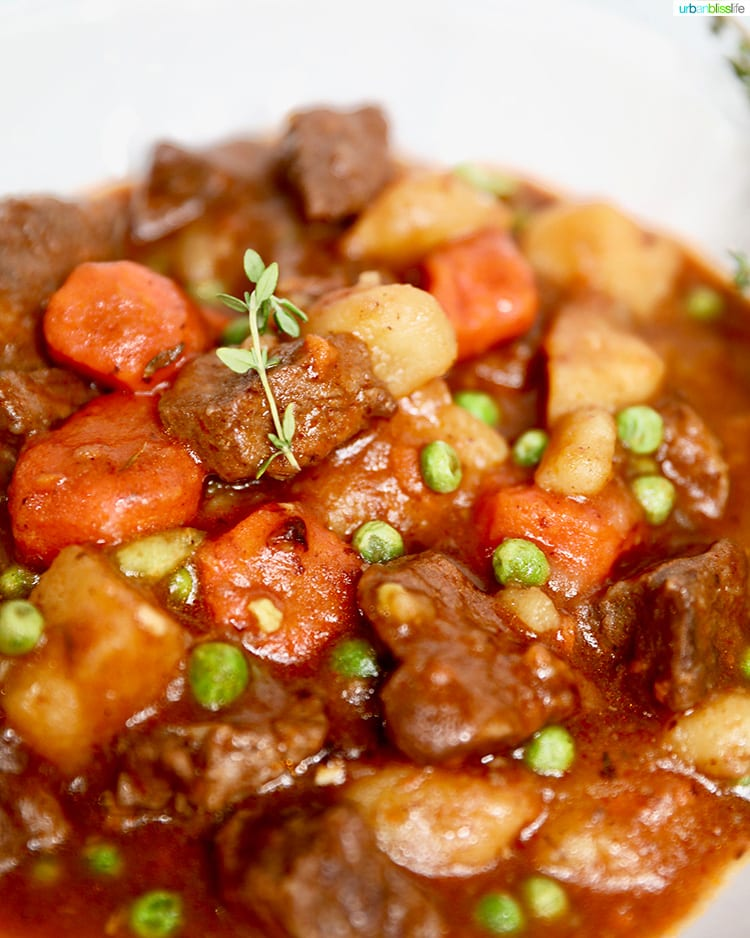 close-up photo of instant pot beef stew with peas and thyme