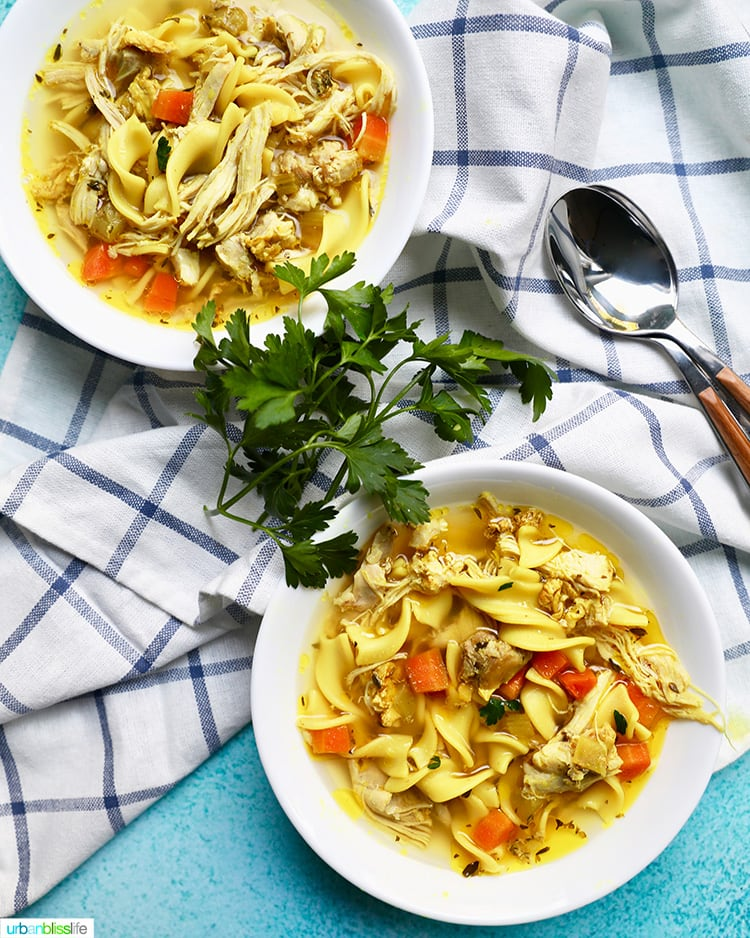 two bowls of immune boosting chicken noodle soup made in an instant pot