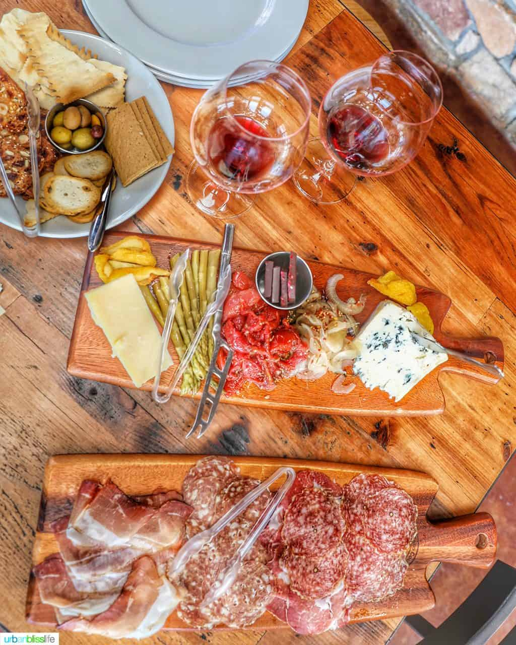 red wine glasses with charcuterie boards at Lenne Estate