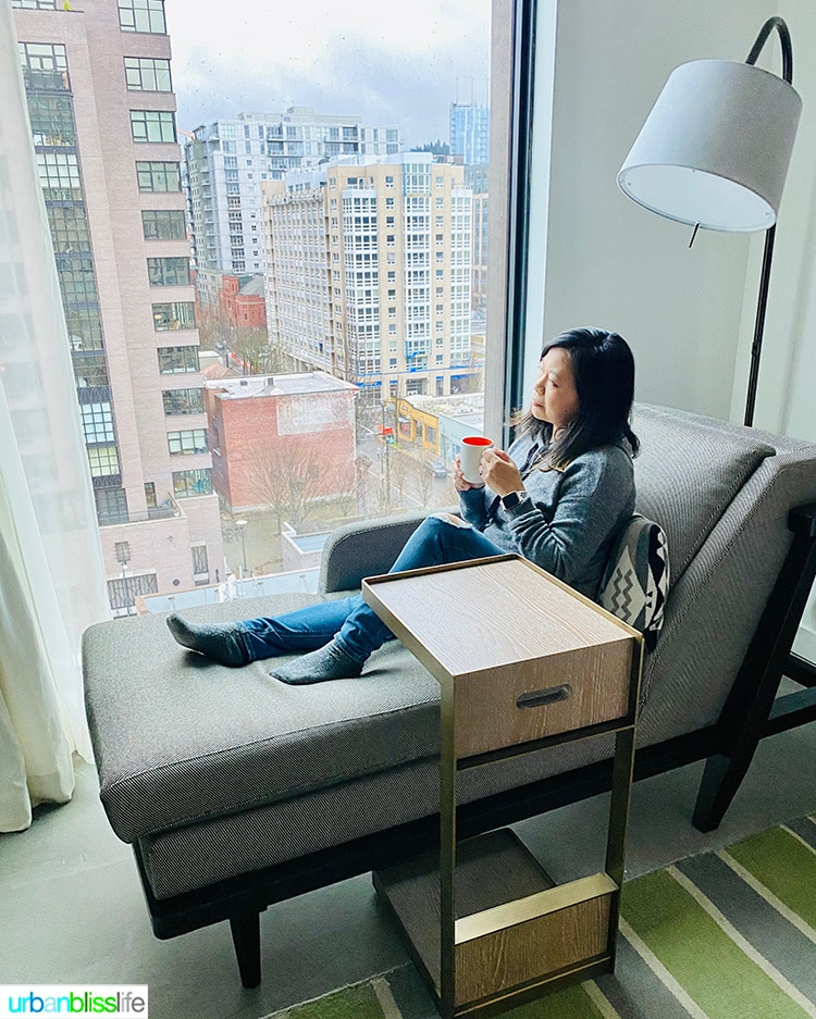 Marlynn in window seat overlooking the Pearl District at Canopy Hilton hotel