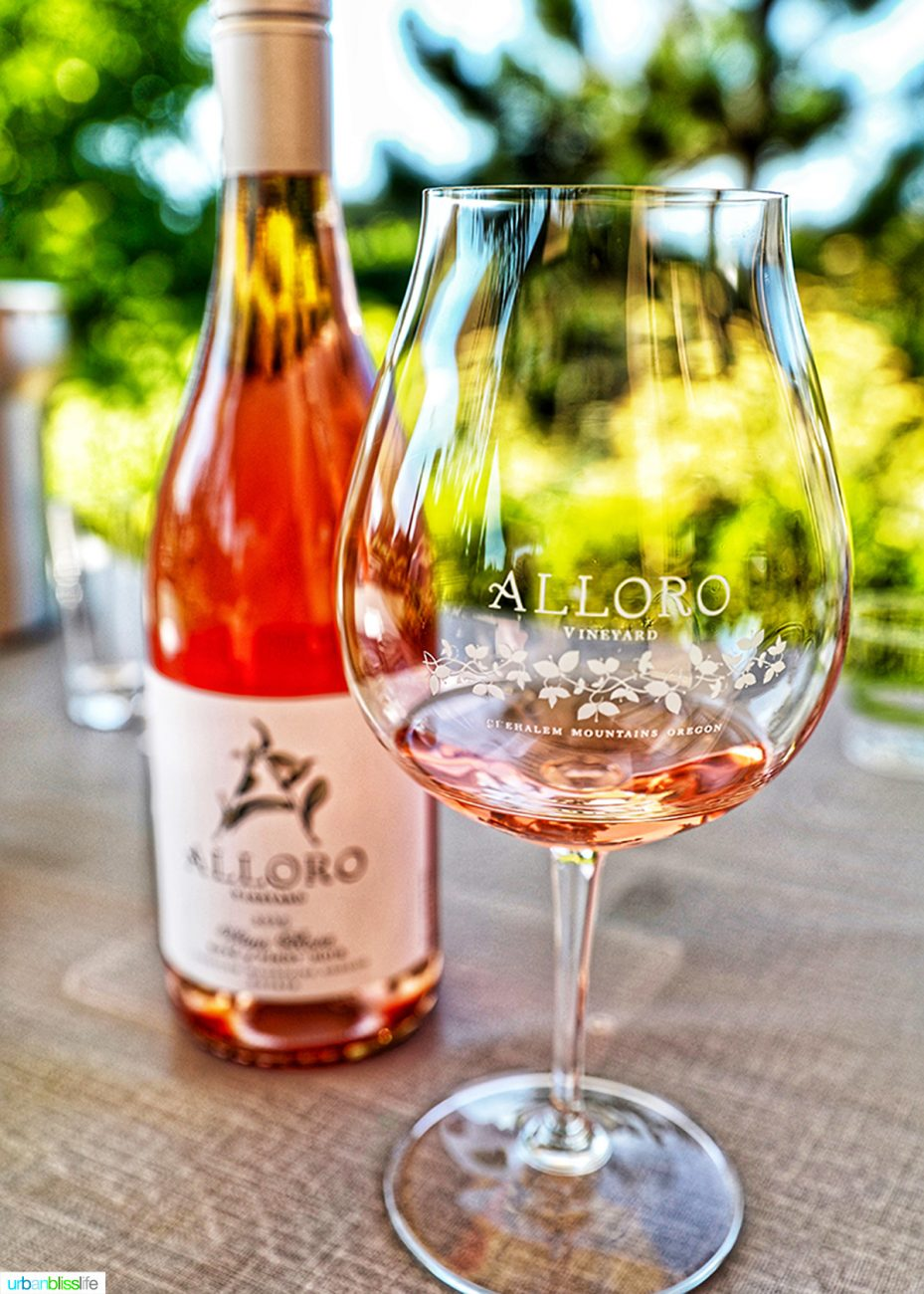 Glass and bottle of Alloro Vineyards rose