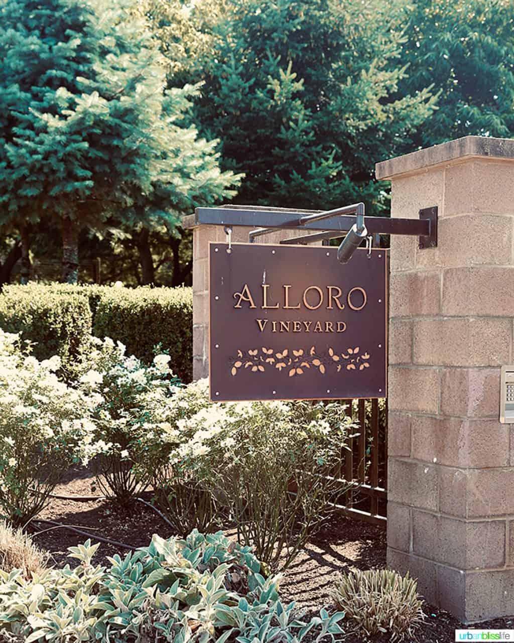 Alloro entrance sign