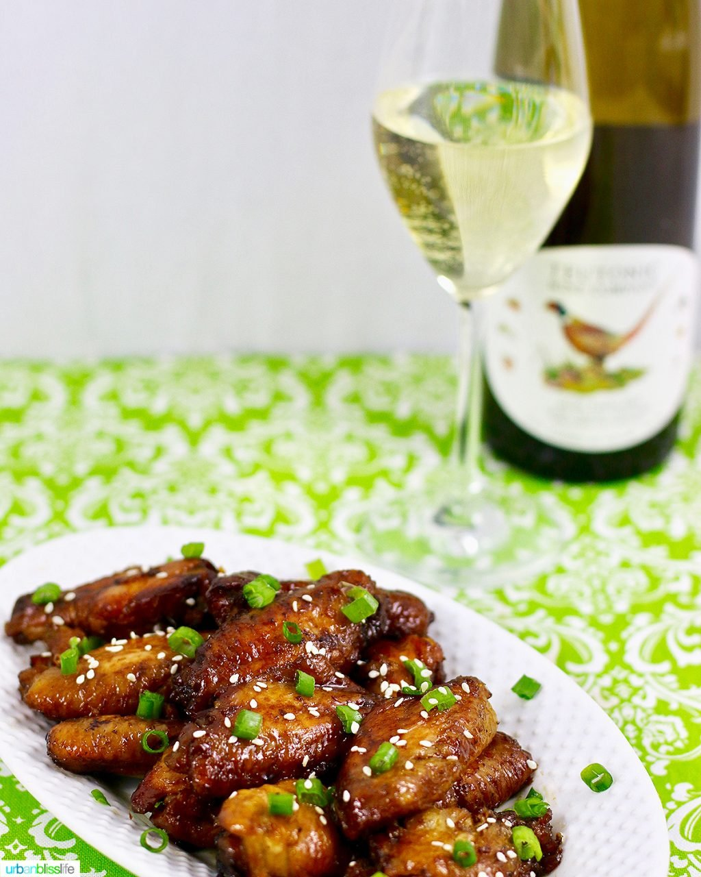 teriyaki chicken wings with a glass of Teutonic Riesling white wine