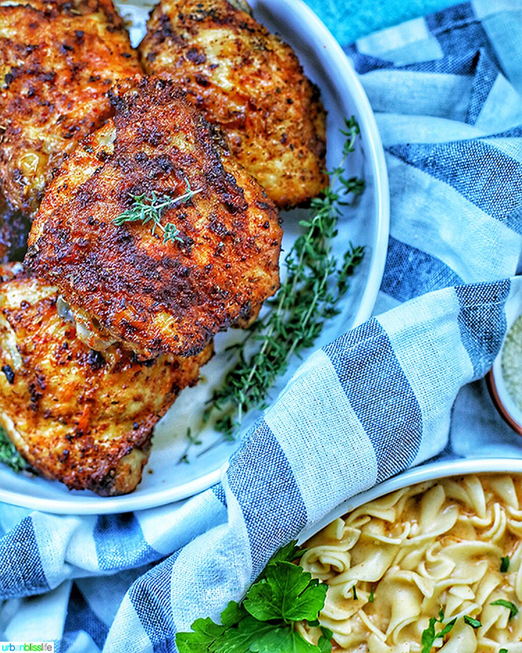 bowl of air fryer paprika chicken with bowl of paprika pasta