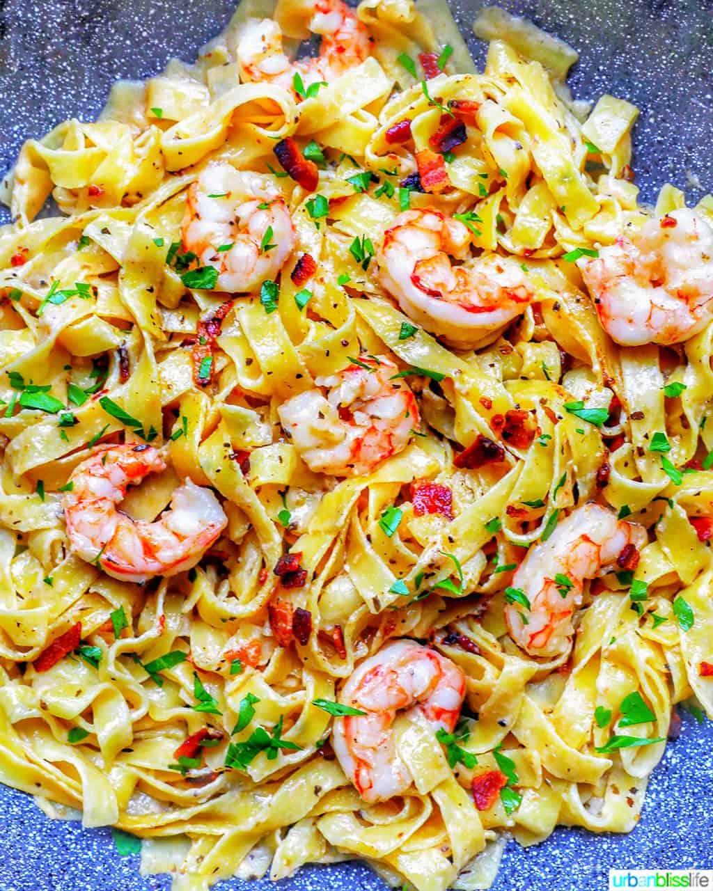 full photo of bacon shrimp pasta in pan