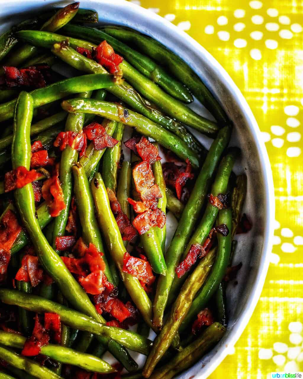 half bowl of green beans with bacon