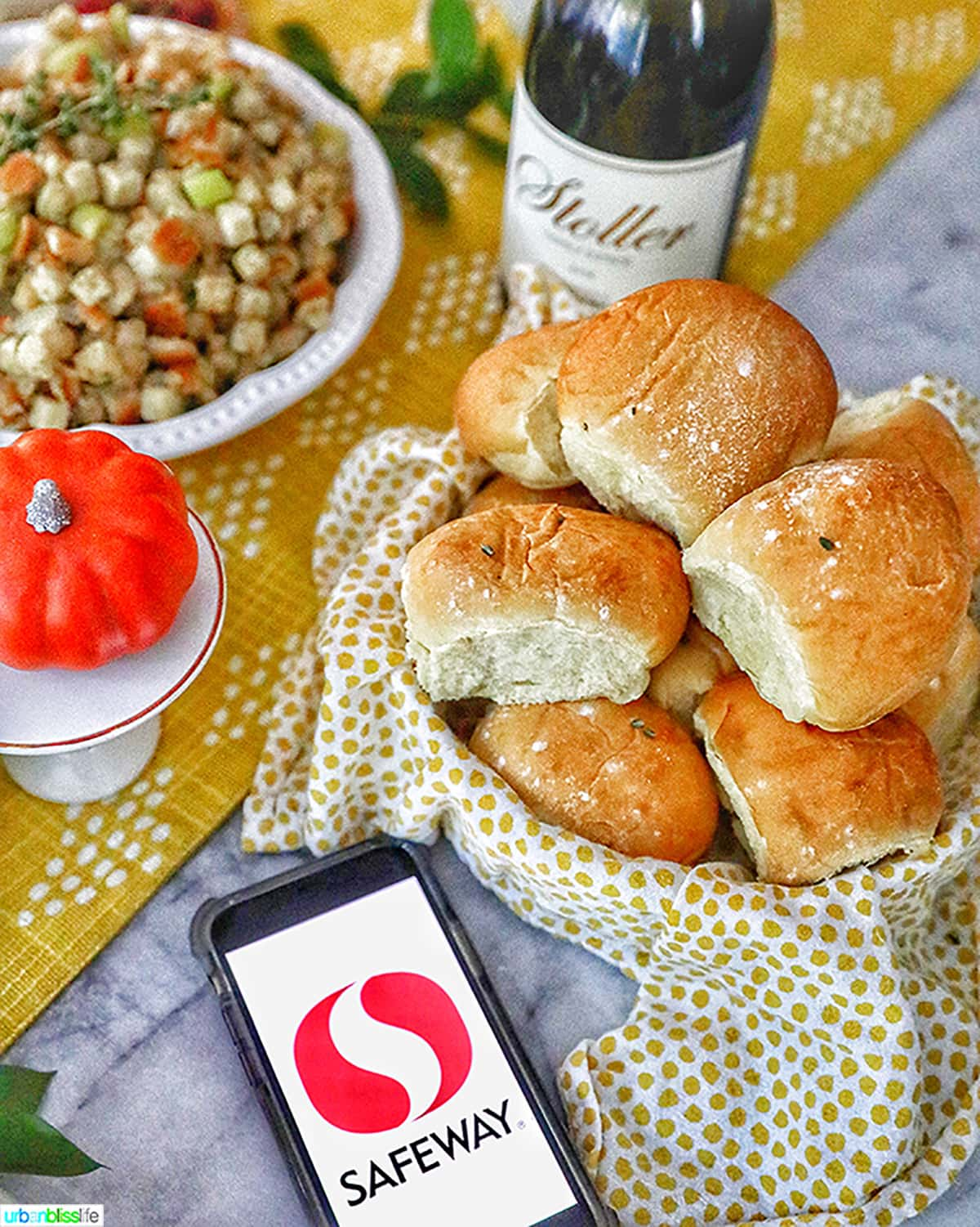 dinner rolls in a basket with safeway logo on phone