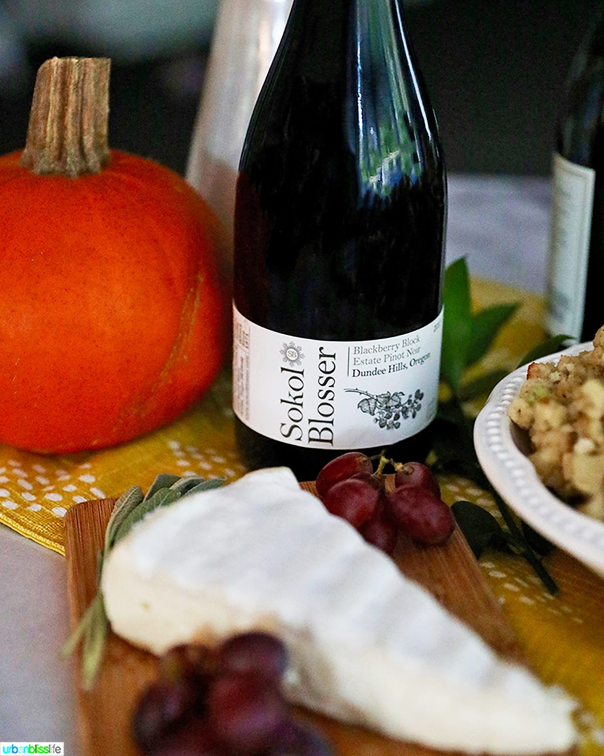 bottle of sokol blosser wine with brie cheese and grapes