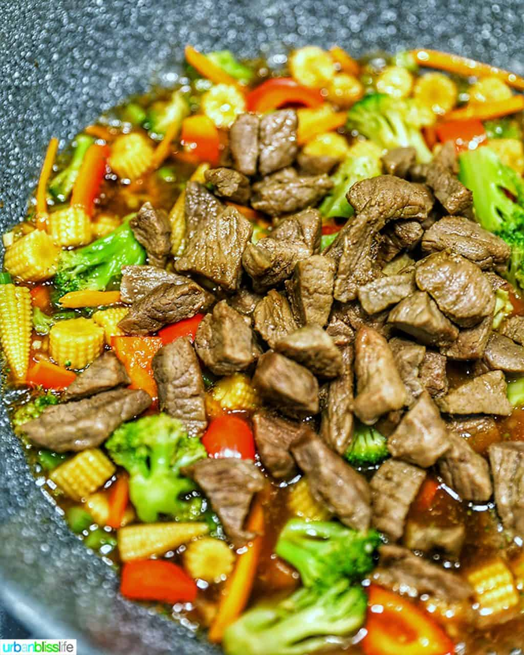 beef and veggies in wok