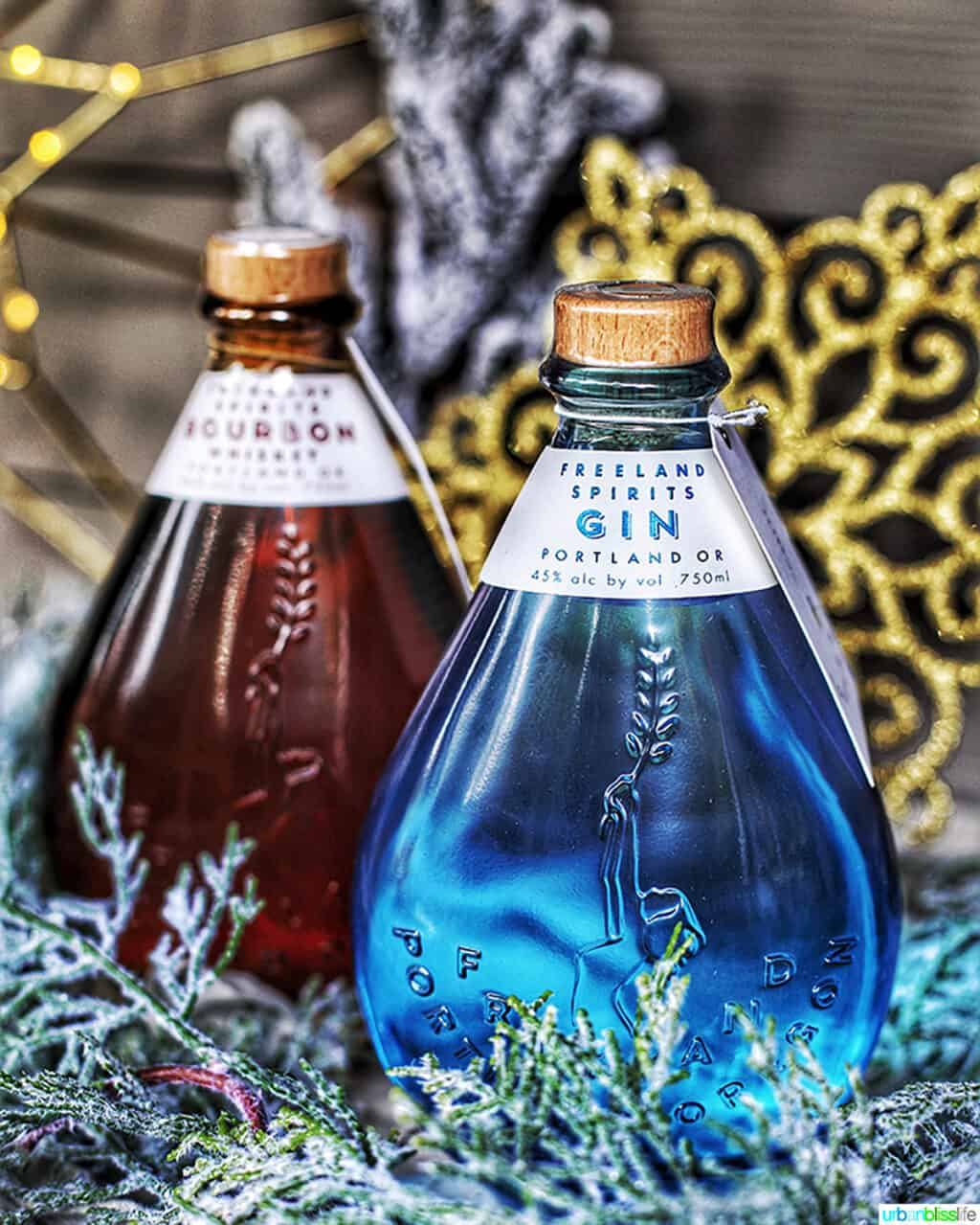 Freeland Bourbon and Gin bottles in holiday setting