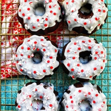 six mini gingerbread bundt cakes on a baking rack with red and white napkin
