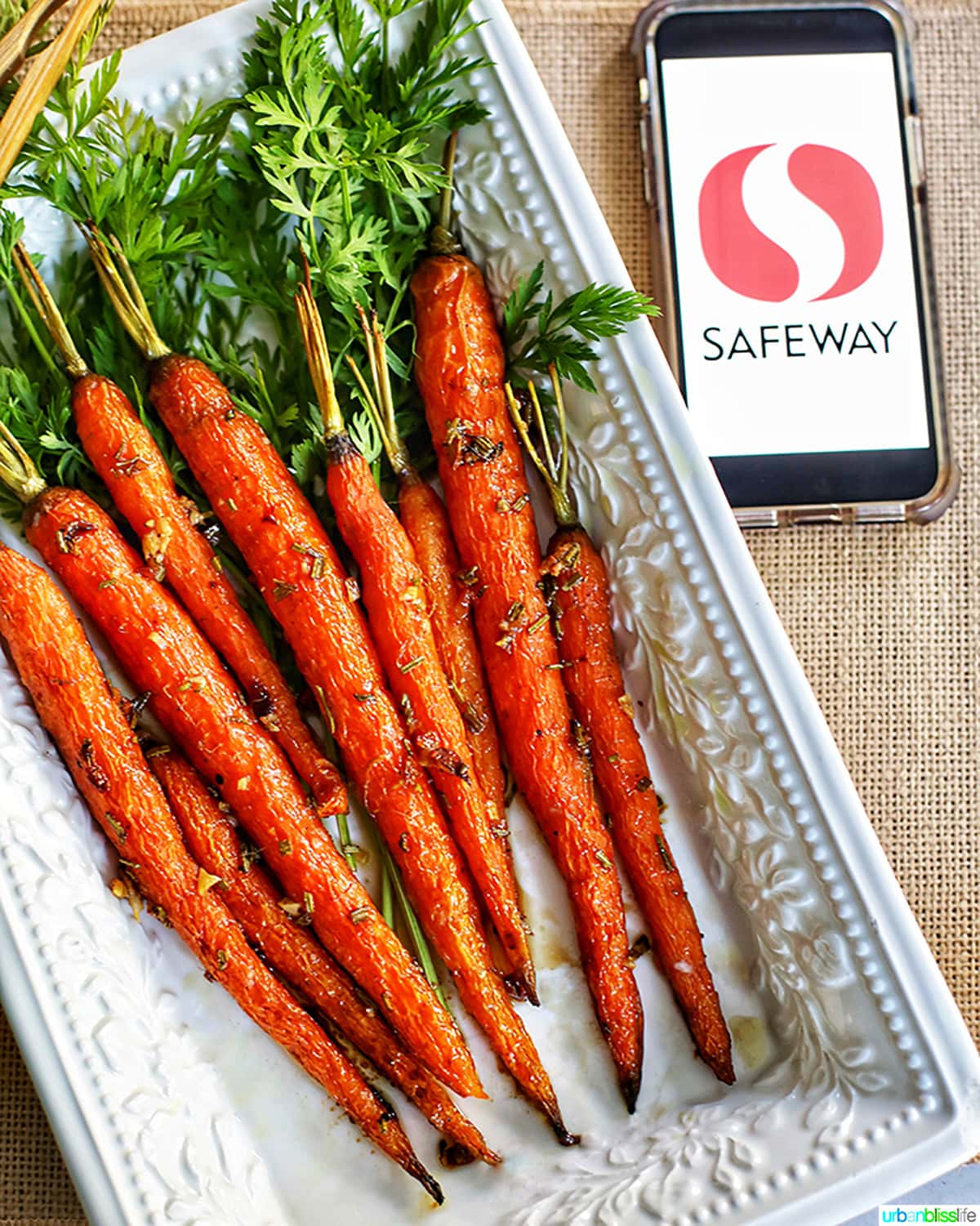 glazed carrots on white plate with safeway logo on phone