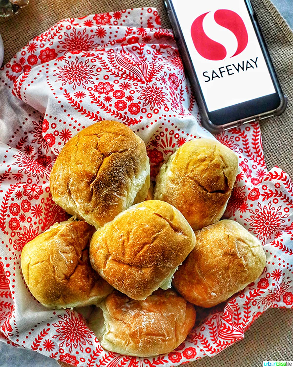 dinner rolls against red and white towel with safeway logo on phone