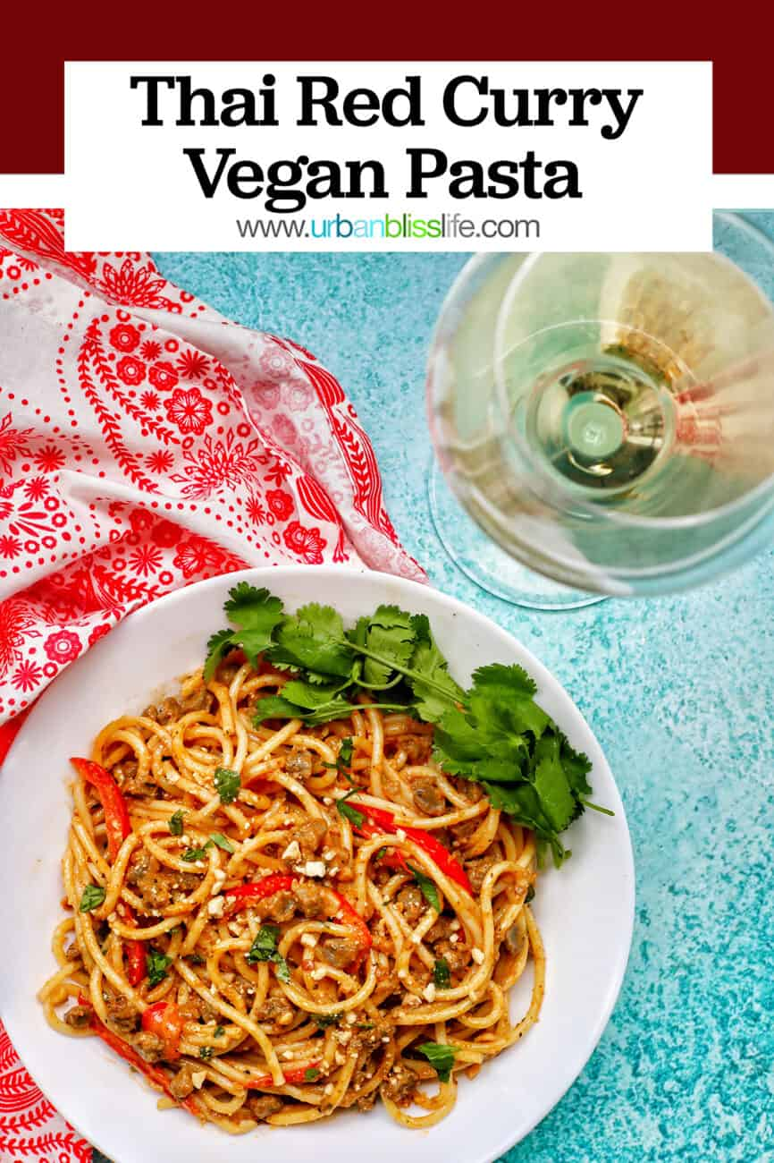 bowl of Thai Red Curry Pasta with glass of white wine and title text