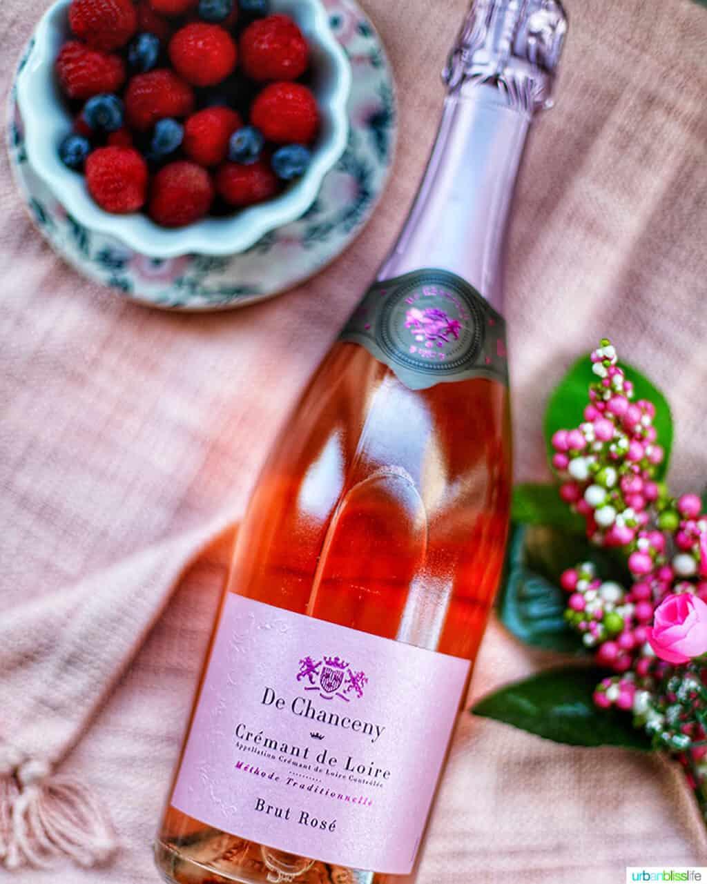 De Chanceney Cremant de Loire bottle with flowers and bowl of fruit