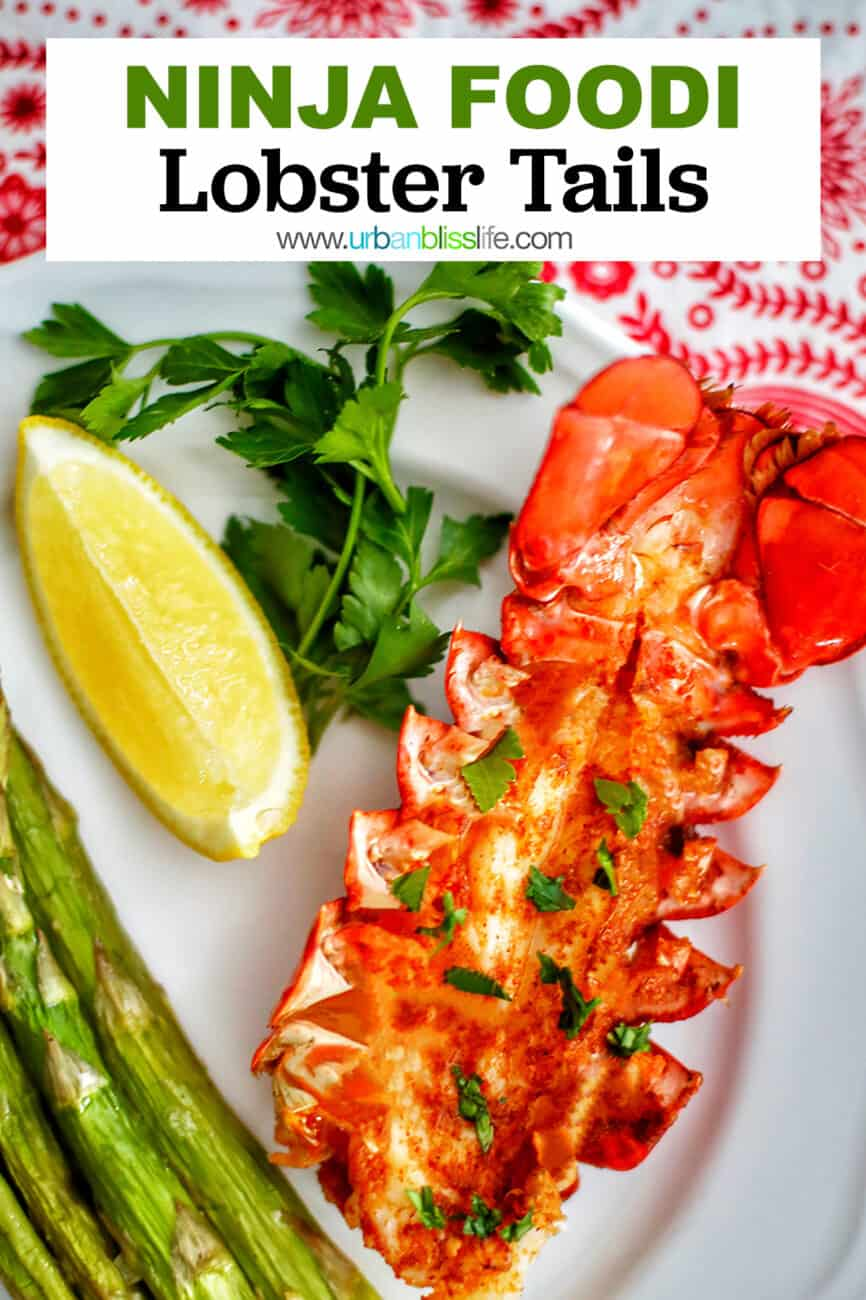 lobster tails with lemon wedge and asparagus and text for Pinterest