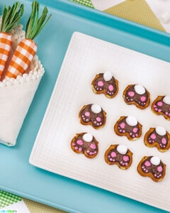 cute Easter bunny pretzels on blue tray
