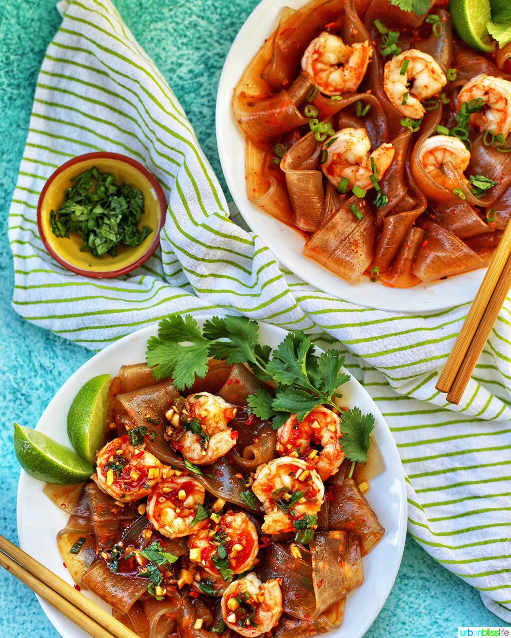 two bowls of wide glass noodles with shrimp